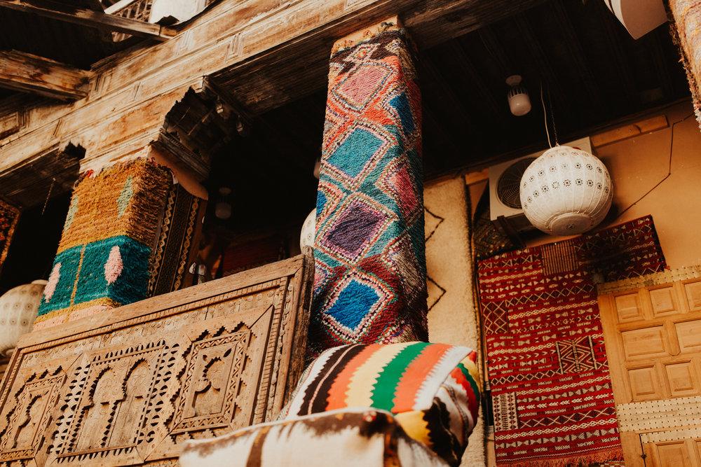 Rugs wrapped around pillars