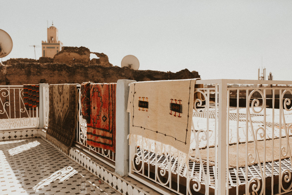 Our view from lunch with Saeed: rugs, rooftops, and the mosque