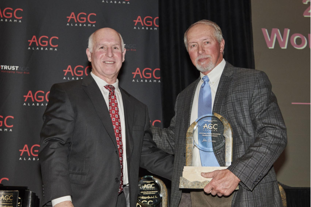 John Garrison (Garrison Steel) of Pell City (right) receives the Alabama Associated General Contractor's Gary Savage Workforce Development Award at their annual banquet last week. Gary Savage (left) presents the award to John Garrison. Photo submitted  Edward Badham
