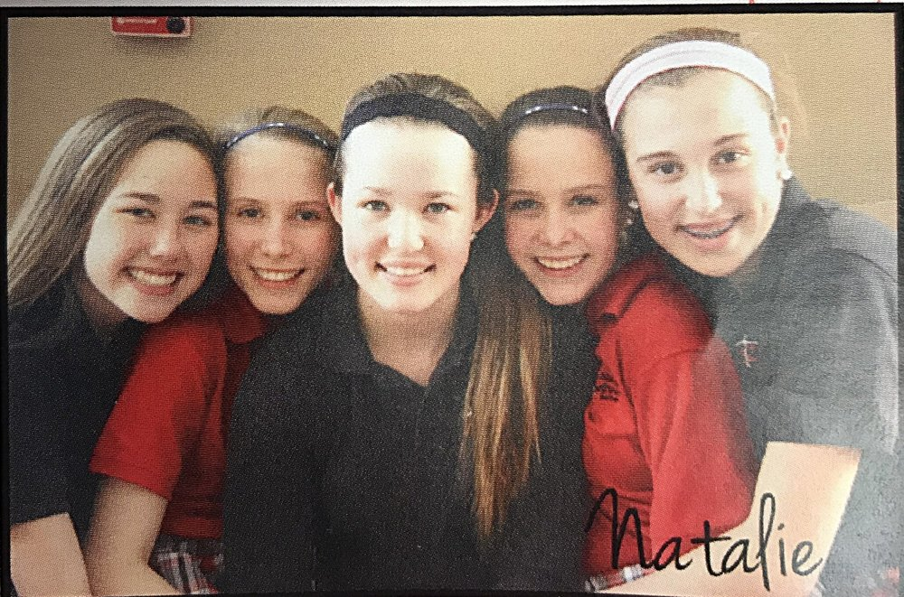 Natalie and friends during their 8th grade year at ASLS.