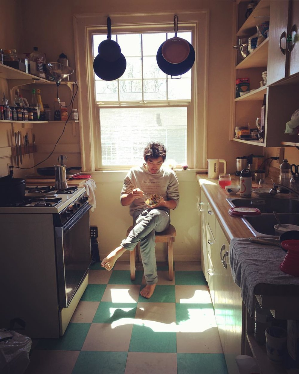 The sunny little kitchen is everyone's favorite spot in the Kim apartment
