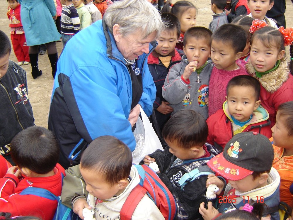 Ida with school children.JPG