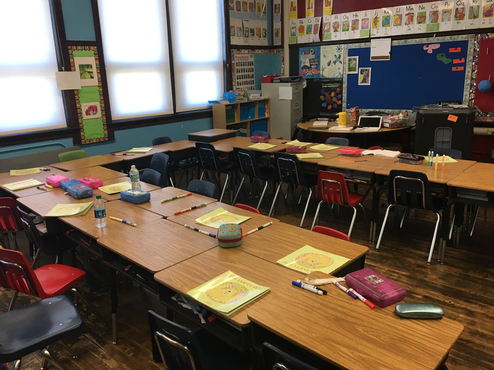 Books donated from SWS scattered across students' desks in Ms. Diane Cross' third grade classroom at Bennett Elementary in Detroit, one of the two classrooms in which the Spring 2016 pilot program was implemented.
