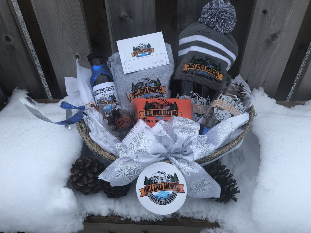 The holiday basket includes; $25 gift card, Zip up sweatshirt, T-shirt, Beanie, Growler, Pint, Snifter glass, House BBQ, Sticker and Key chain.