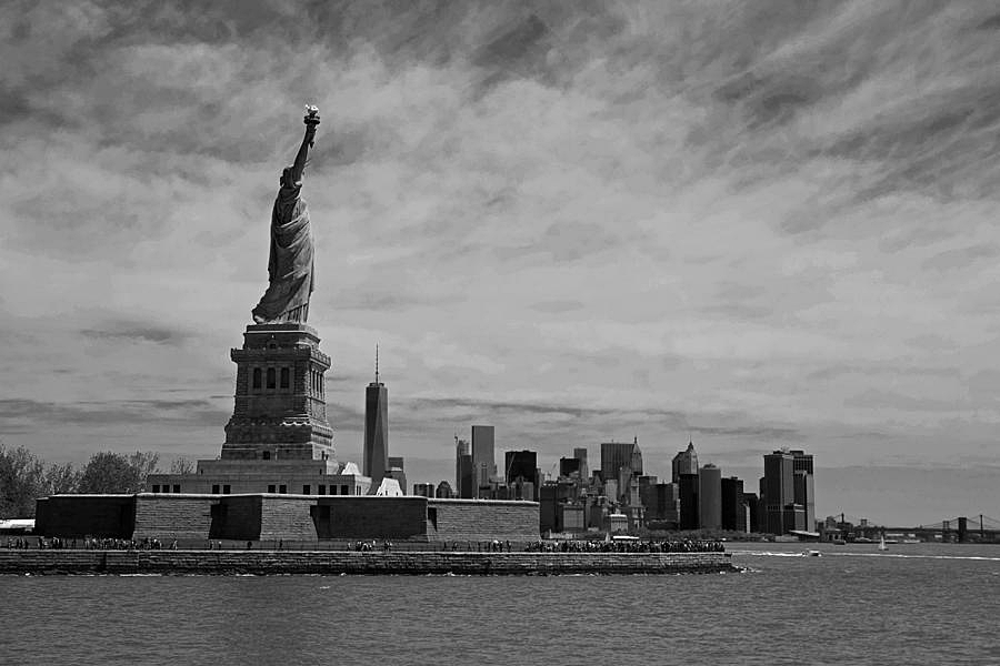 lady-liberty-overlooking-new-york-city-black-and-white-toby-mcguire.jpg
