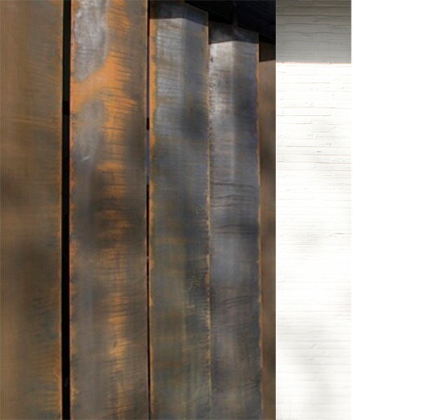 The rusted steel solar shades at  Pagliacci Main  contrast with the adjacent white painted brick walls.