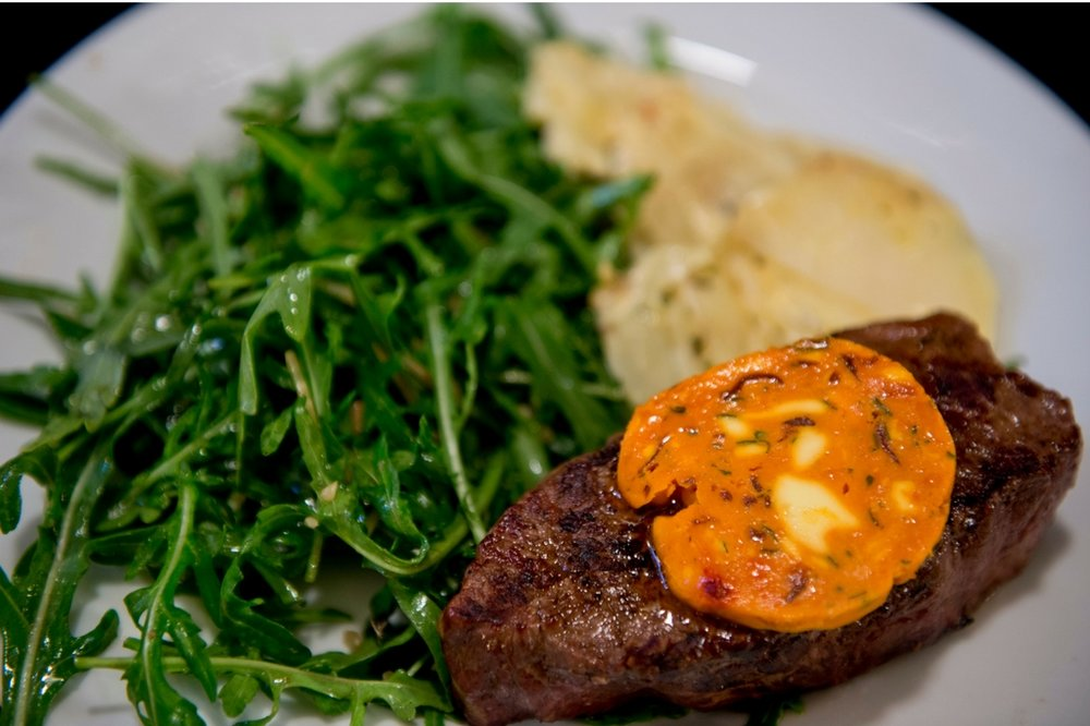 steak night - Do you enjoy a steak? Join us on Wednesdays for our mouth-watering steak night. Our 300g porterhouse steak with roquette, creamy scalloped potatoes, and parmesan salad will delight forr only $18. Why not add a slather of our delicious garlic butter?
