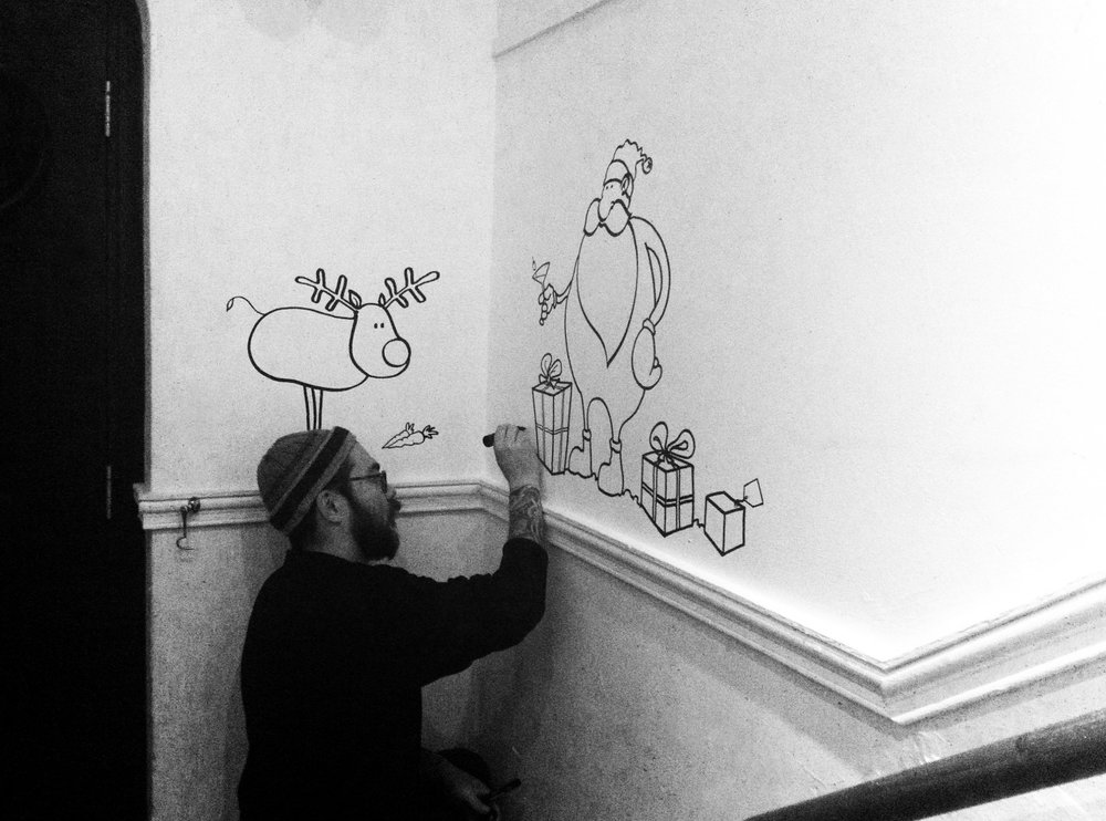 DECK THE HALLS II  wouldn't be complete without at least a little bit of a mural. This year we asked the multi-talented Paul Harris of  Philip Browne Menswear  to draw a variation of his Christmas card design onto the wall. You can find more work-in-progress shots on his Instagram  here .