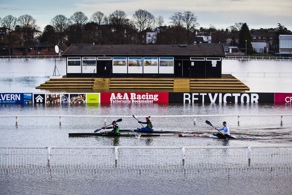 Rowers on a flooded Worcester Racecourse