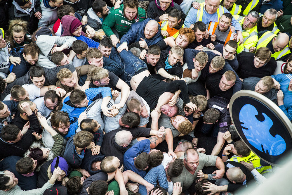 The Atherstone ball game forms a huge scrum outside a bank in Atherstone town centre, Warwickshire