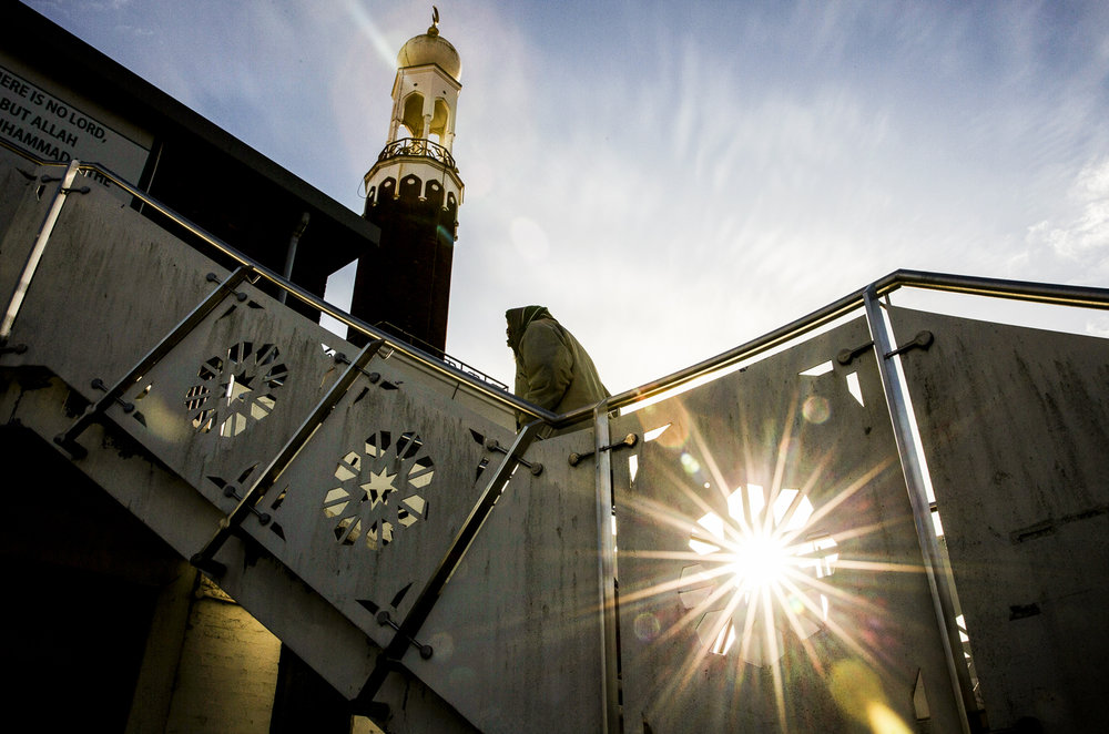 A man arrives at the Birmingham Central Mosque in Birmingham for Midday prayers.