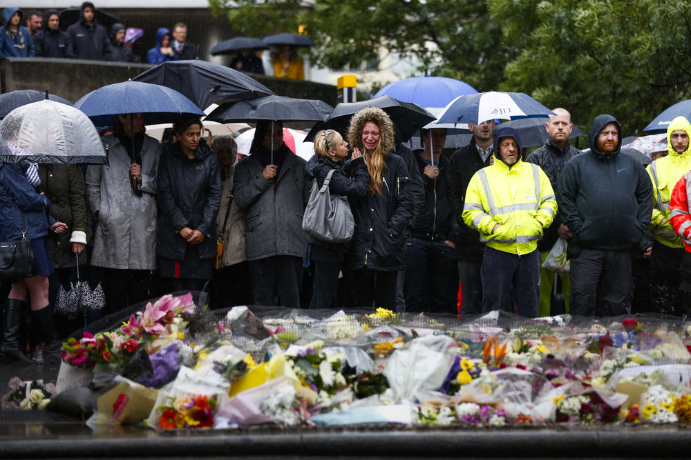 People near London Bridge observe a minutes silence for the victims of the terror attacks in London.