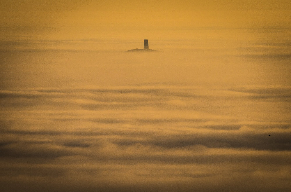 Glastonbury Tor seen above fog