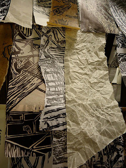 installation for  Prints: Breaking Boundaries  (Portland Public Library), detail of roof, relief ink, woodblock printing, beeswax, milk paint, xerox copies, various paper types relief ink, woodblock printing, beeswax, milk paint, xerox copies, various paper types, 2012