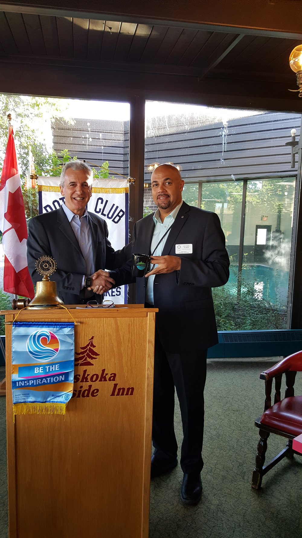 Rick Dalmazzi presenting the Founders Circle mug to Michael Duben who is the Bracebridge Muskoka Lakes Rotary Club rep