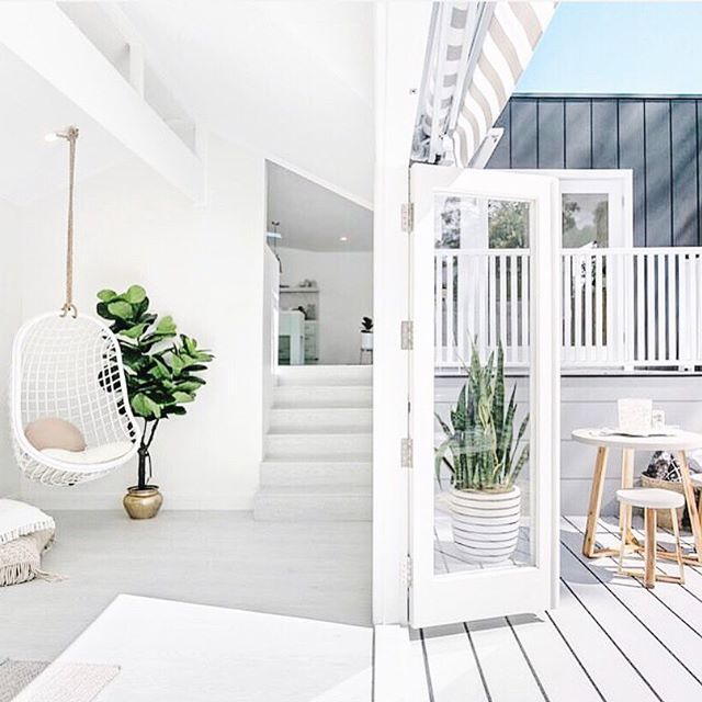 "I came across this scroll stopper account @threebirdsrenovations and immediately fell in love with their designs and philosophy...""family comes first"". Since we are all wanting Spring, I chose this beautiful indoor/outdoor space. These three besties, Bonnie, Erin and Lana left the corporate world to have their own business renovating homes. Now they get to spend their time doing family first and creating beautiful homes together. @threebirdsrenovations is definitely an account you will want to follow. ⭐️ ⭐️ On a side and wonderful note, we have family visiting this weekend and we are heading to the mountains to ski (yes ski) on Saturday and explore Denver today. When someone visits ""you"" what is the number one thing you like to do? Ski, go out to eat, shop, explore, relax, hike, go to the beach? Would love to know please...👇🏻👇🏻👇🏻 . . . . . . . . . . #beachhouse #beautifulhome #coastalliving #exteriorinspo #fiddleleaffig #followfriday #greenery #hangingchair #homeinspo #homerenovation #housetohome #indooroutdoorliving #onetofollow #outdoorfurniture #outdoorliving #outdoorlivingspace #outdoorroom #outdoorspace #outdoorspaces #remodeling #renovation #roomandboard #snakeplant #thedarlingmovement #thatsdarling #theeverygirl #whitedecor #whitehome"