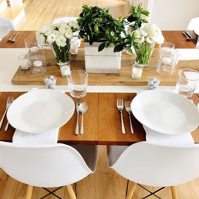 "We love having friends over for dinner...here is my RECIPE for ""a"" simple, yet sophisticated table setting🍽: ⭐️ INGREDIENTS: •White paper rolled down the middle of the table secured underneath with painters tape at each end. •A cutting board to stage with flowers🌷and candles🕯. •White flowers and greenery🌿. In this case a combination of flowers and a gardenia plant. Covered the wooden planter with a strip of the same white paper that's on the table accented with a jute twine wrapped around it. •Drinking glasses. •White plates. •White flour sack towels for napkins. •Candies🍬at each place setting. ⭐️ INSTRUCTIONS: •Set table🍽. •Good conversation😀. •Laughter😂. •Shared stories. •Enjoy!❌⭕️ What is that one must for you in your ingredients or instructions?👇🏻👇🏻👇🏻 . . . . . . . . . . #allmodern #apartmenttherapy #beautifulhome #beckiowensfeature #betterhomesandgardens #crateandbarrel #cratestyle #currenthomeview #dominomag #everydayibt #flowersinbloom #freshflowers #ggathome #hgtvhome #hbmystyle #howyouhome #iheartthishaven #landgathome #littleaccountlove #marthastewart #mybhg #myhousebeautiful #myhgtv #myhouzz #myoklstyle #onekingslane #sharemysquare #smmakelifebeautiful"