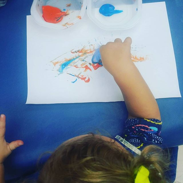 One of my favorite projects is not-paintbrushes! It's where you paint with a tool that isn't normally a paintbrush. Here you see a super sweet toddler using a feather to add paint to the page. #bbla #toddler #babiesofig #sandiego #sdpreschool #painting #feather #artproject #artideasforkids #socal #sandiego