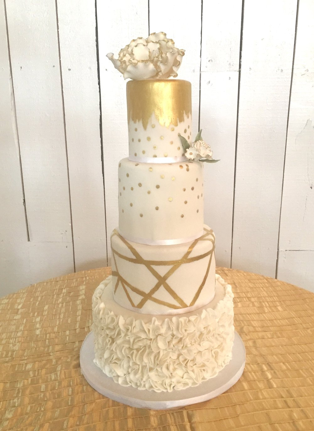4 Tier Gold and White Wedding Cake