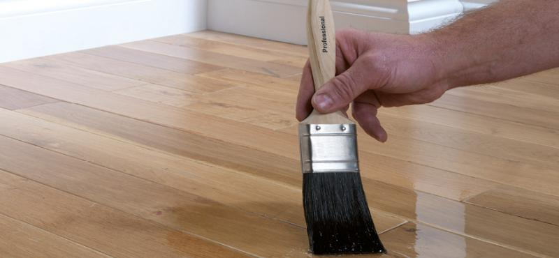 applying-varnish-on-the-wooden-floor.jpg