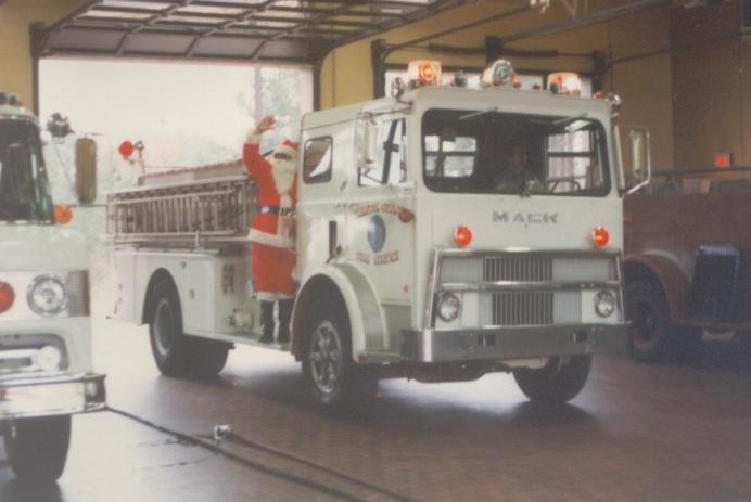 Santa Claus on the old Mack engine.