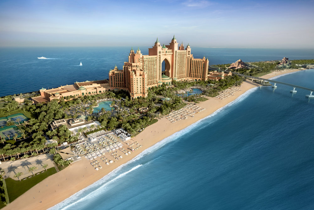 "Atlantis – The Palm, Dubai   The large hotel complex is located on the man-made Palm which features some of the most luxurious facilities in the world featuring two towers, water theme park and beach front.   The $1.2 Billion US project scope for Dubai includes:  - The Royal Towers - 1,200 rooms  - The Coral Tower - 800 rooms  - 1.5 mile beach front  - 60 acre water-theme park for 6,000 visitors daily  - Unique water attractions, one of the world's largest man-made marine habitats, snorkel trail, dolphin experience, water slides and The Dig, an Atlantis-themed ""archeological"" experience  - Two-storey, 86,000 m2 conference centre which includes a 21,000 m2 ballroom 80,000 m2 Entertainment Village featuring 20,000 m2of retail space with food and beverage establishments  - Monorail system with an end terminal at the retail centre to transport hotel and water park visitors.  - 1000 car parking spaces below grade  Photo Courtesy of Atlantis – The Palm, Dubai"