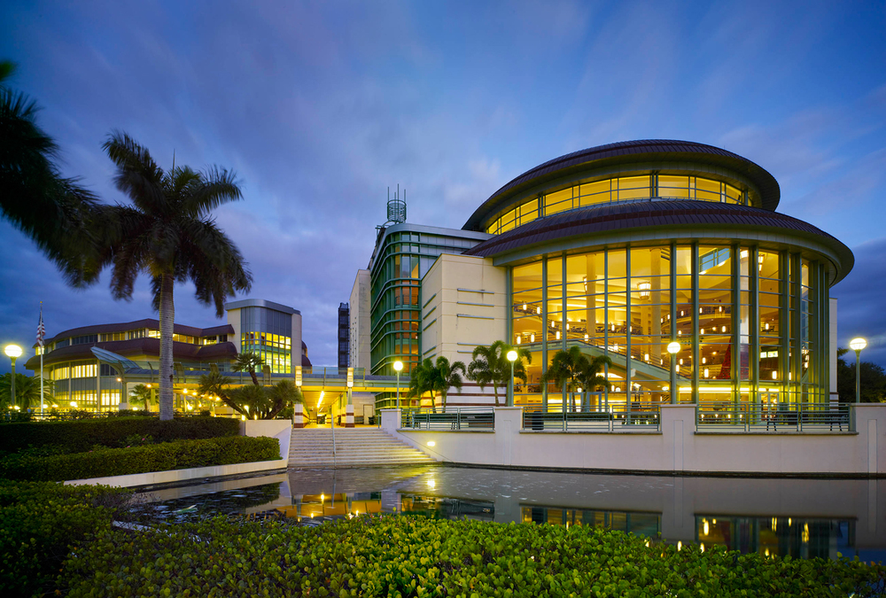 Raymond F. Kravis Centre for the Performing Arts, West Palm Beach Florida   Located on a prominent 5.4 acre site, the exterior of this 200,500 square foot facility features a vast bi-level copper roof while the interior has a 45-foot high glass-walled lobby with a white marble grand stair case to the upper tiers. ( click for more )  Award: 1997 - Florida Design Arts Award in Recognition of Design Excellence  Photo Courtesy of Zeidler Partnership Architects, Tom Arban Photographer