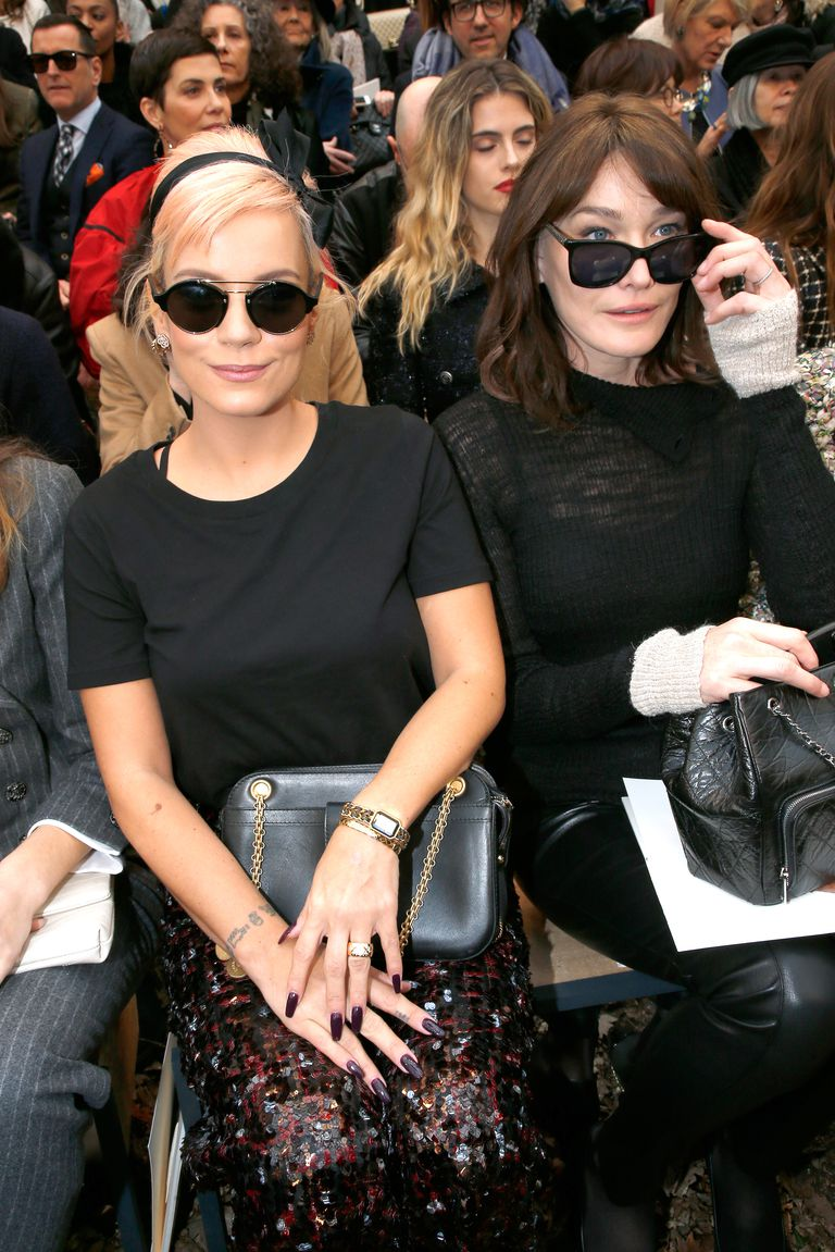 Lily Allen and Carla Bruni sit front row at Chanel