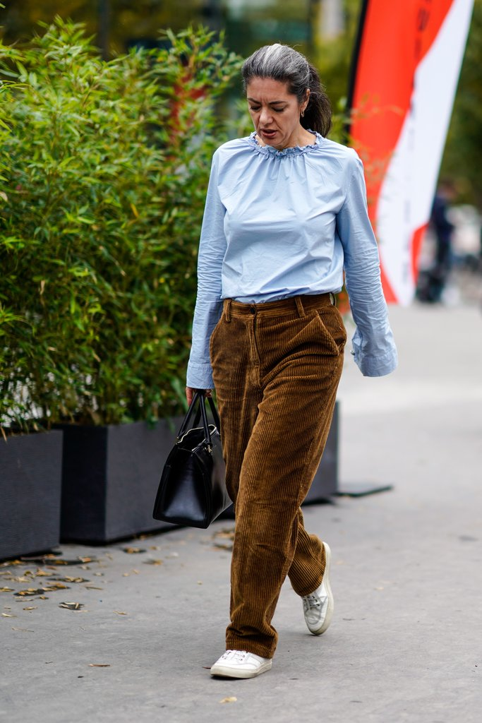 Give a pale blue blouse the 2018 treatment by pairing it with wide-leg corduroys and trainers.