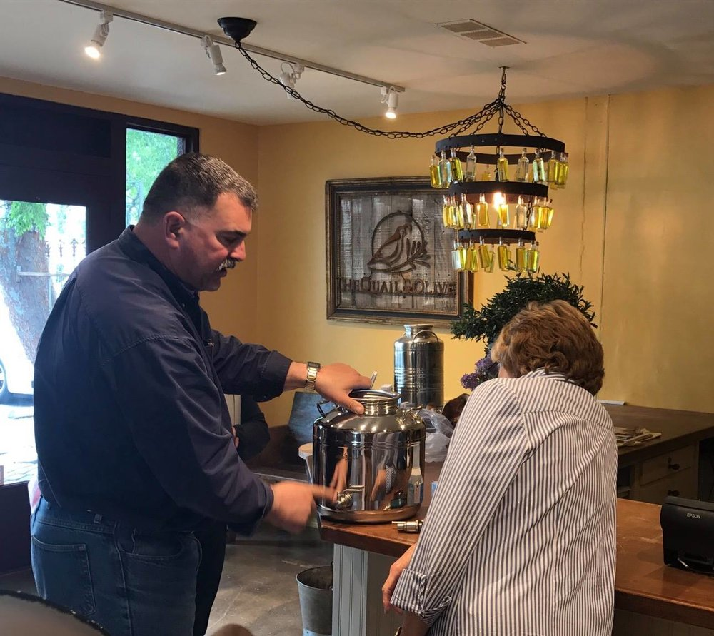 Our COO, Lane Landry, demonstrating our fusti to Deb, manager of Quail & Olive in Carmel Valley, CA.