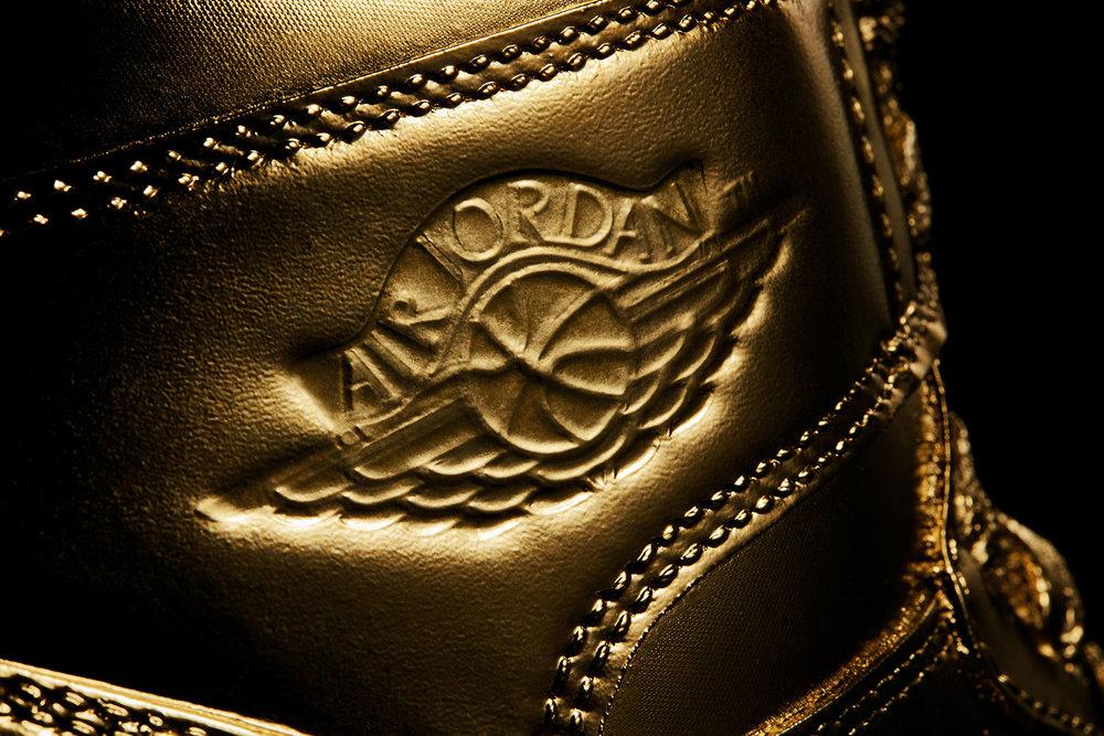 tom-medvedich-still-life-matt-senna-gold-jordans-logo.jpg