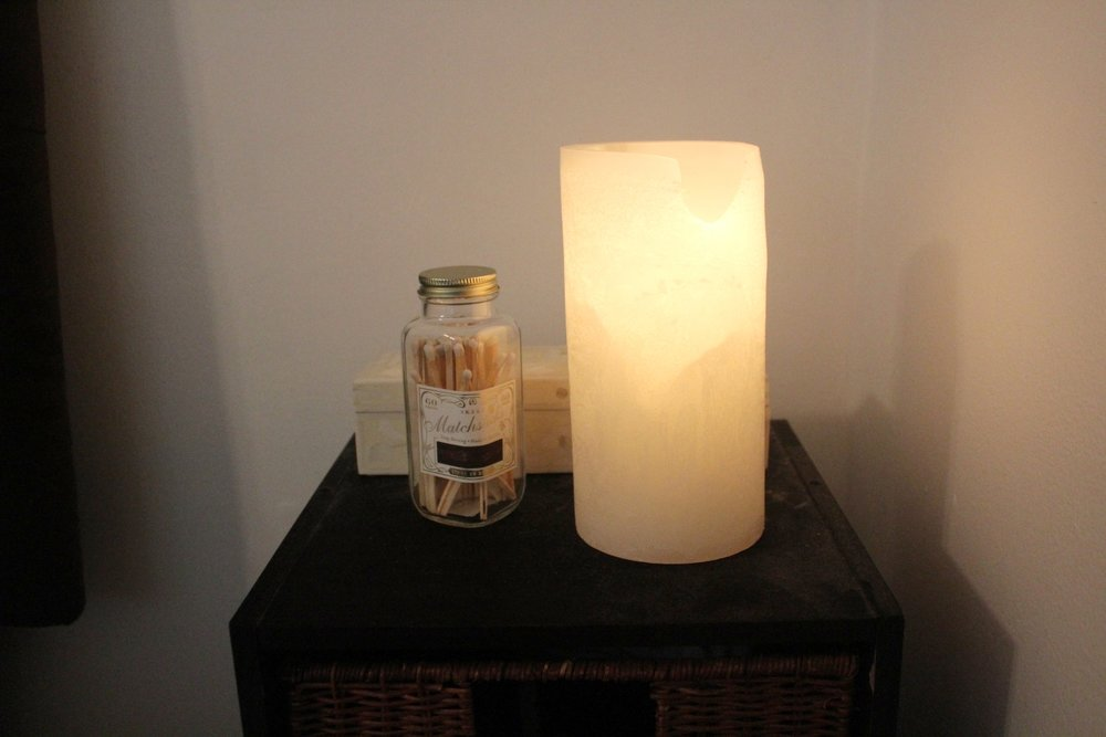 WINTER - An ivory color palette with a large candle keeps this bedside table warm and simple.