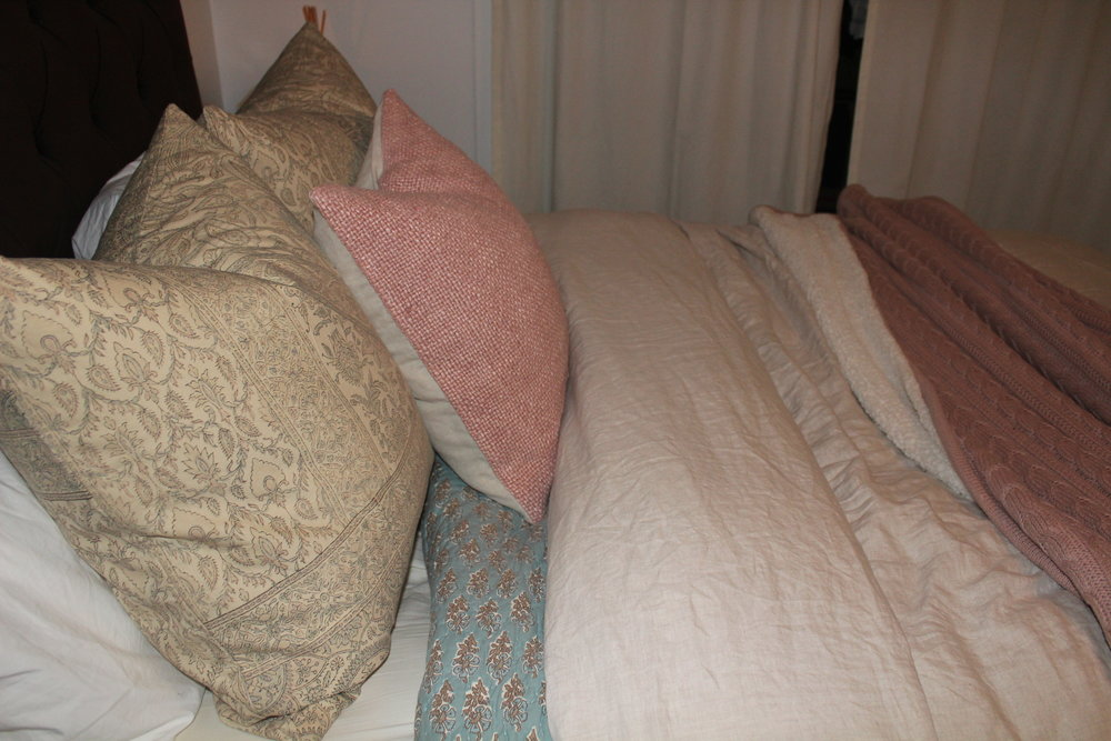SPRING - Start with a patterned quilt, add the neutral duvet, then top it off with a cozy/colorful throw. The standard sleeping pillows are tucked behind two 24