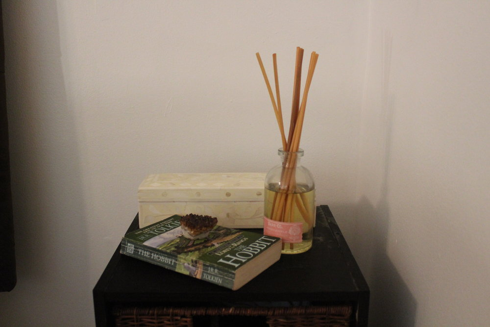 SUMMER - A good book and a nice scented diffuser on this bedside table keep it simple and cute.