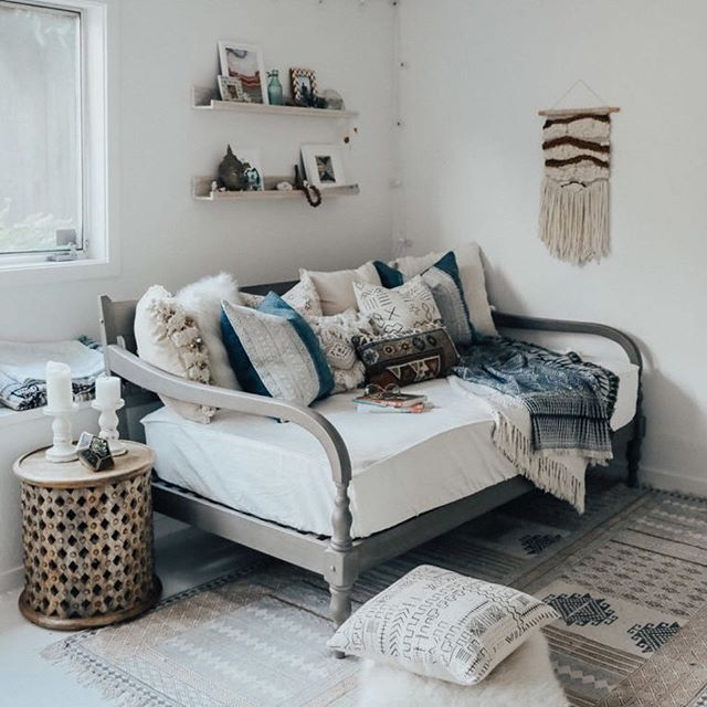 Instagram @advicefroma20something .  This daybed sofa has a lush cozy look with lots of pillows and throws, but the color palette is simple and doesn't overwhelm the space!