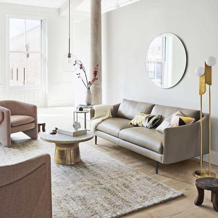 WestElm.com . This sofa has a more modern style with only two pillows (in coordinating patterns) and a neutral throw adds warmth but is not a focal point.