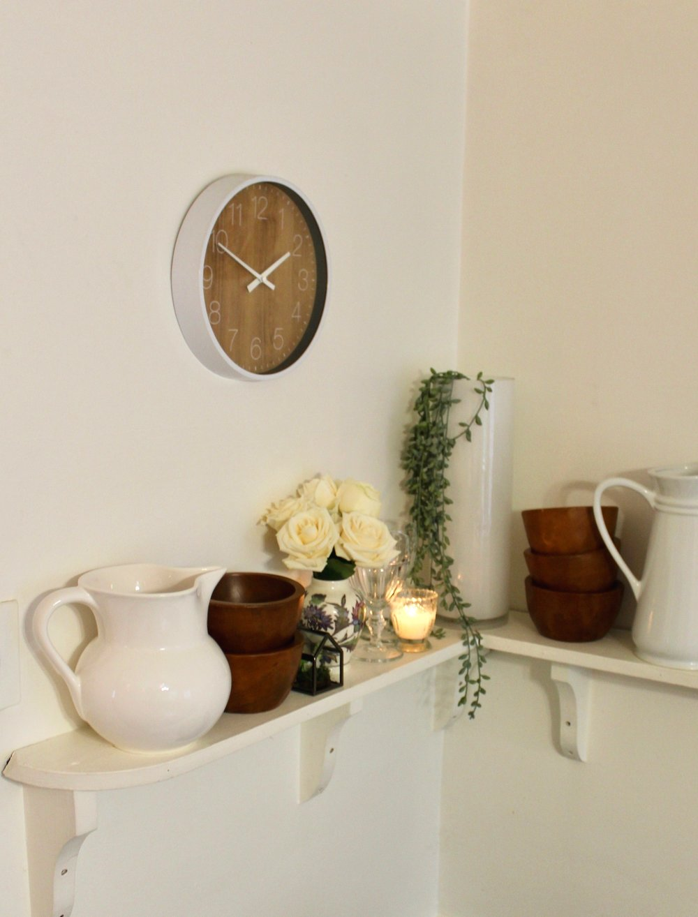 Round Wall Clock $8.99 - I bought this clock when we first moved into our apartment, I was looking for something simple & mainly white so this was perfect! It is one of the very few things I have never switched out because it goes with everything!Click here to shop