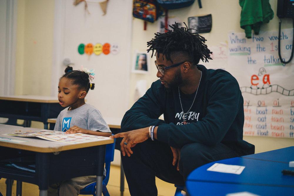Small Girl Reading and Teacher.jpg