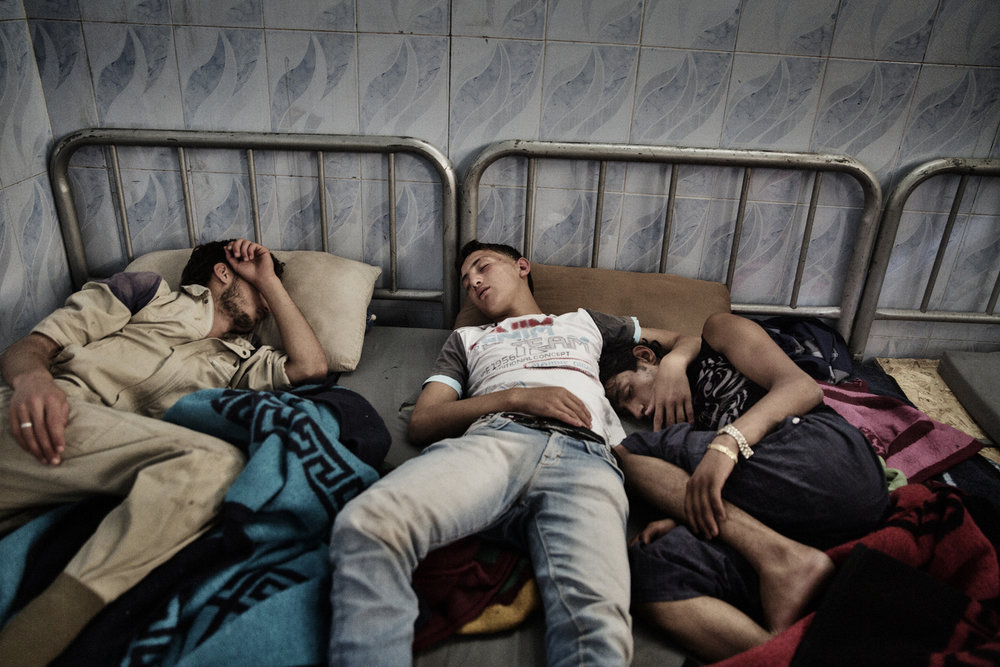 Civil Defense rescue volunteers sleep in the basement of their new headquarters, a former school. June 21, 2014.