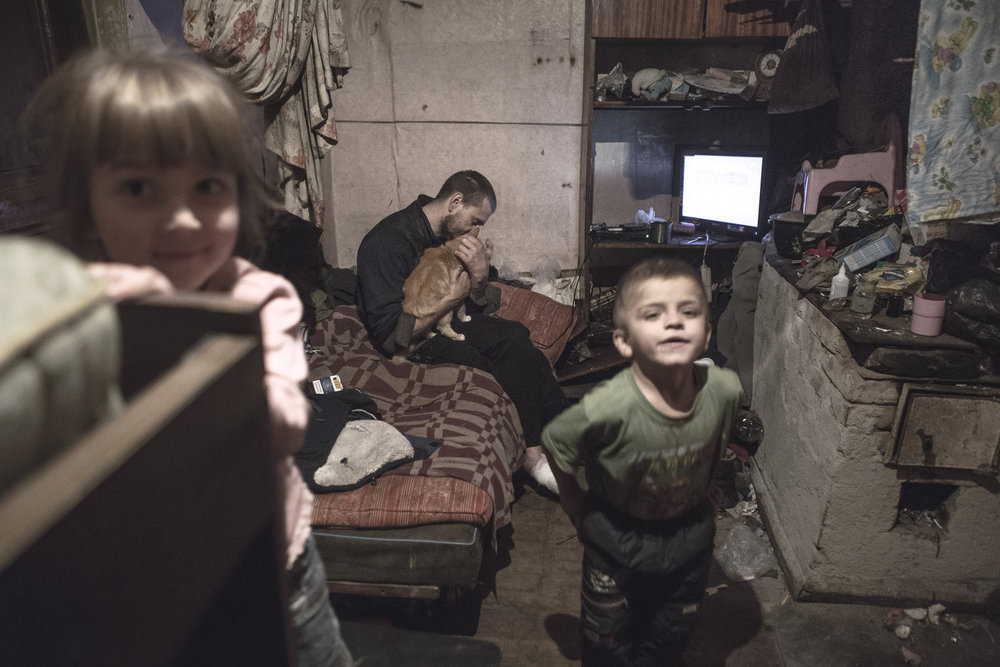 Ruslan's house burned down a few years ago. Today, he is living in a shabby hut on the outskirts of the city. There is no water supply, sewer, or central heating.