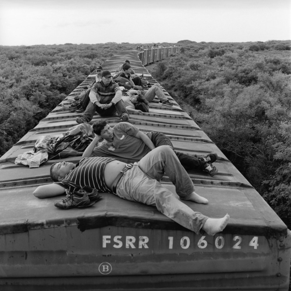 Undocumented Central American migrants ride a northbound freight train through the southern Mexican state of Oaxaca—the first leg of their journey by rail to the U.S. border. July 2010.
