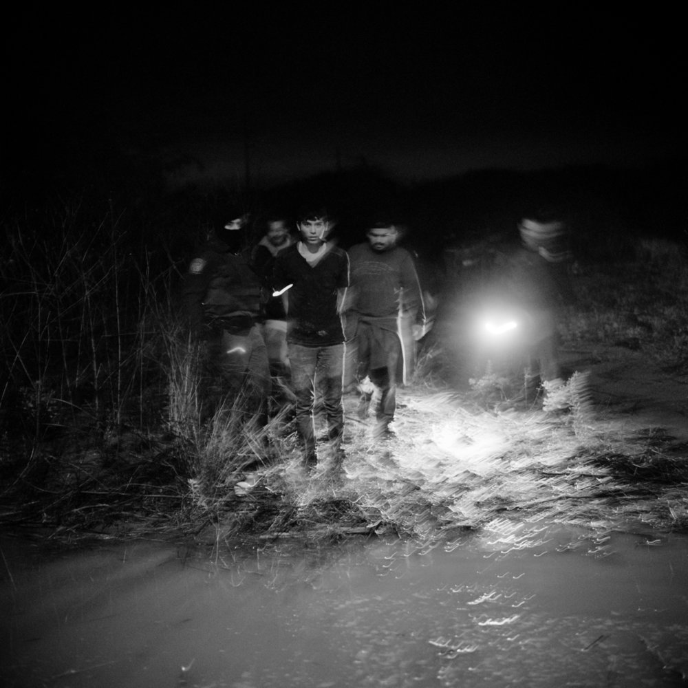 A group of undocumented Central Americans are captured by U.S. Border Patrol in the Rio Grande Valley. Near McAllen, Texas. April 2013.