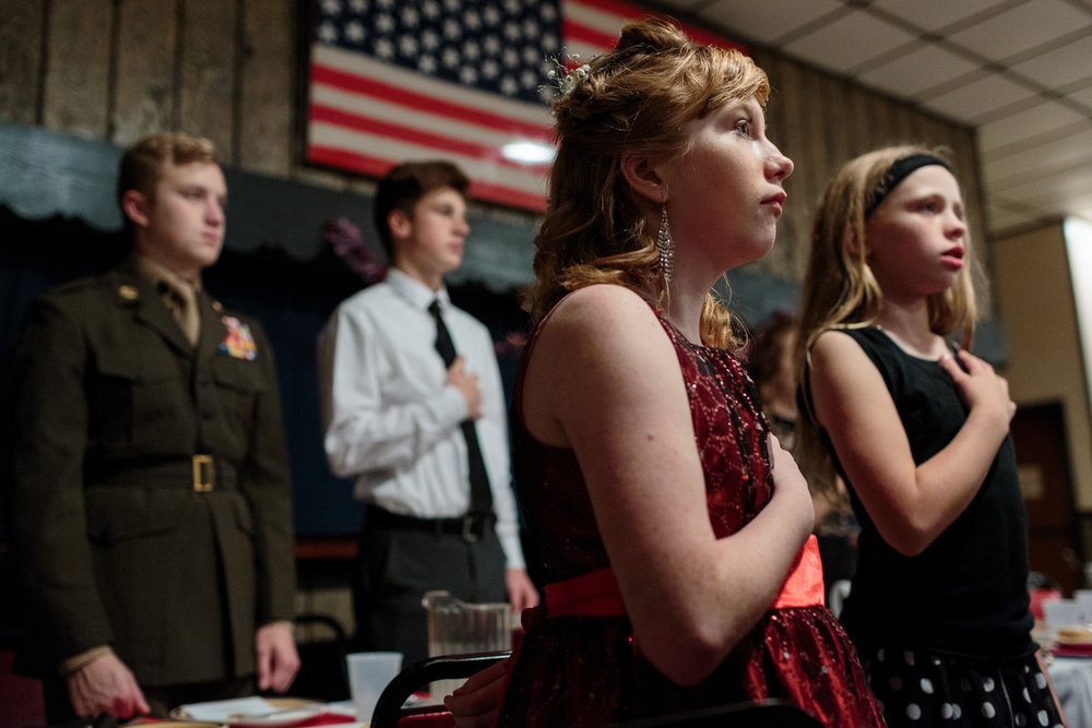 Young Marines recite the Pledge of Allegiance during the opening of their annual ball at their local VFW, 21 Oct 2017, Hanover, PA. Students attend with their families and close friends to celebrate the accomplishments of their fellow cadets. The Young Marines are a non-profit organization with around 10,000 students enrolled nationwide. The program runs year-long, with meetings once a week.