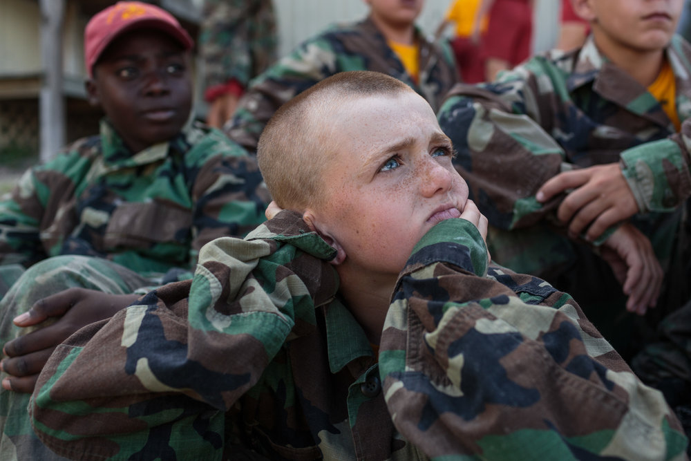 A student at Marine Military Academy, an all-boys institution, waits for a game of paintball to begin during a summer camp on the academic campus of MMA in Harlingen, Texas, 17 July 2017. The camp hosts boys from around the world, ages 12-18, with around 300 cadets in attendance.