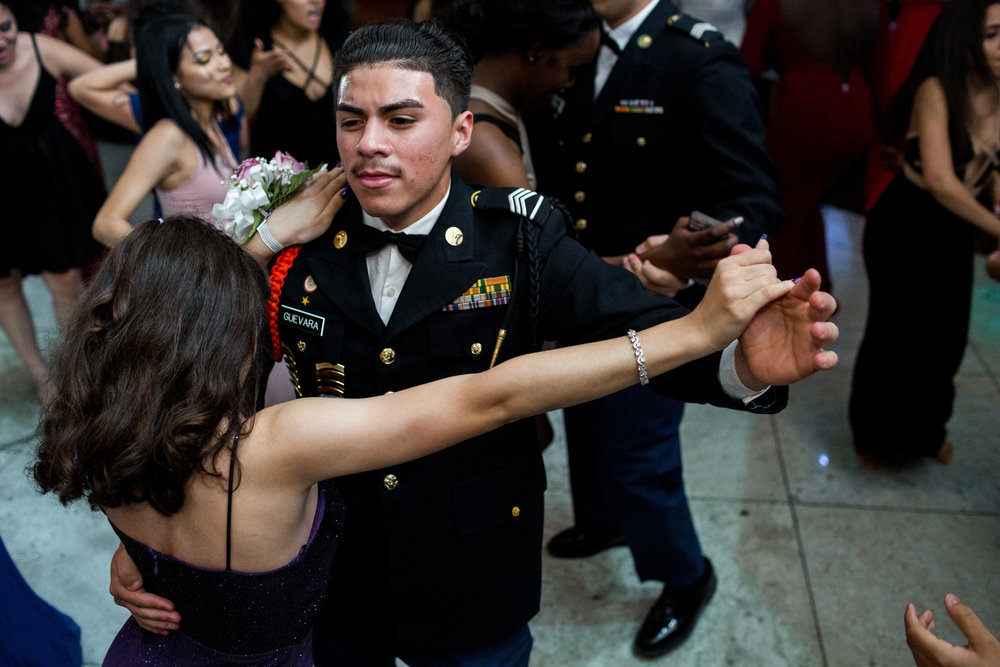 Students from Theodore Roosevelt Educational Campus dance to celebrate the grand finale of its 7th annual JROTC Military Ball at the Villa Baron Mansion, 17 May 2017, Bronx, NYC.