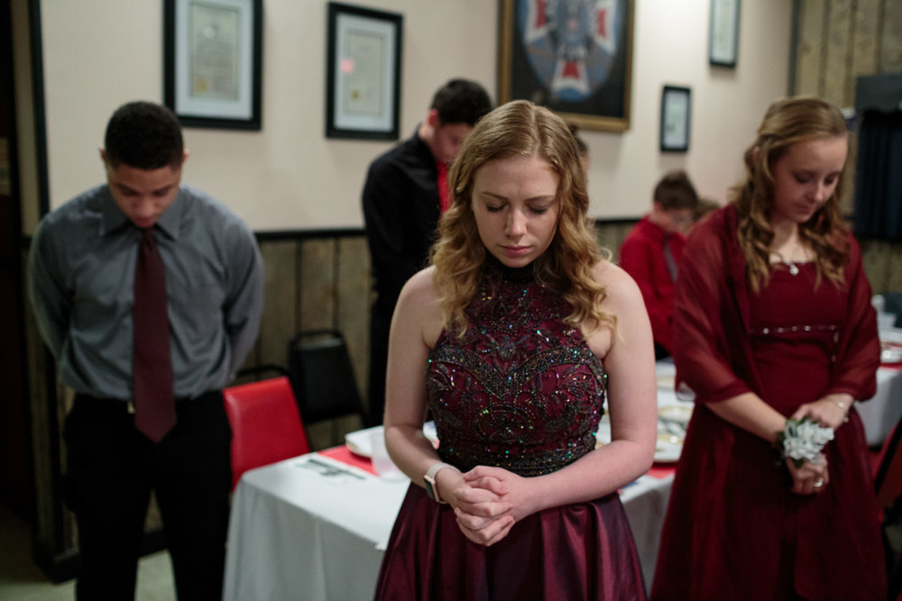 Young Marines pray together during the opening of their annual ball at their local VFW, 21 Oct 2017, Hanover, PA. Students attend with their families and close friends to celebrate the accomplishments of their fellow cadets. The Young Marines are a non-profit organization with around 10,000 students enrolled nationwide. The program runs year-long, with meetings once a week.