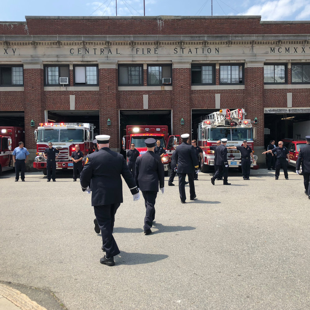 Gloucester Fire and rescue assemble for a funeral in Gloucester, Maine.