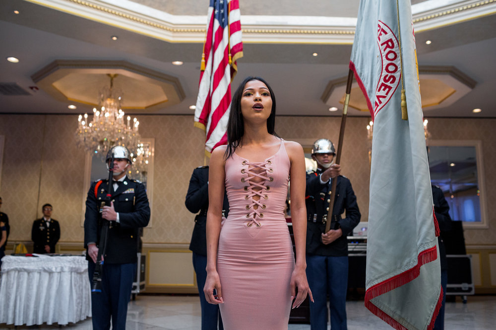 Nicole Gonzabay, a senior, sings the National Anthem, while Theodore Roosevelt Educational Campus celebrates its 7th annual JROTC Military Ball at the Villa Baron Mansion, 17 May 2017, Bronx, NYC. JROTC is one of the largest youth development programs in the world, with over 300,000 students involved.