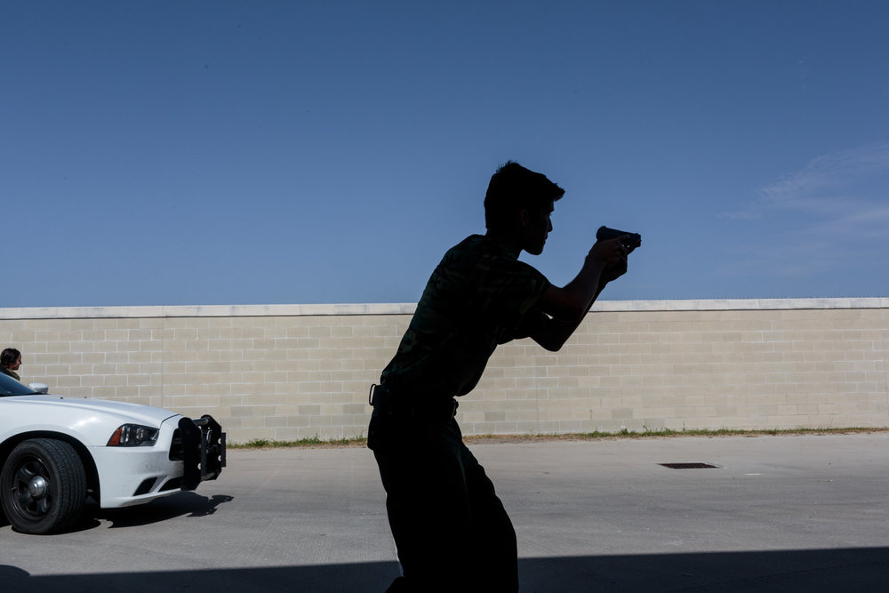 Dominique Duque, a student from the Border Patrol Explorer Program, spends the morning practicing felony (high risk) car stops and searches at at the United States Border Patrol Station in Kingsville Texas Station, 20 July 2017. Kingsville is located in the Rio Grande Valley, and its role is to patrol the largest ranch in Texas. The Explorer program teaches high school students the basics of the Border Patrol. The majority of the students plan to head into the Patrol, law enforcement or militay after graduation.