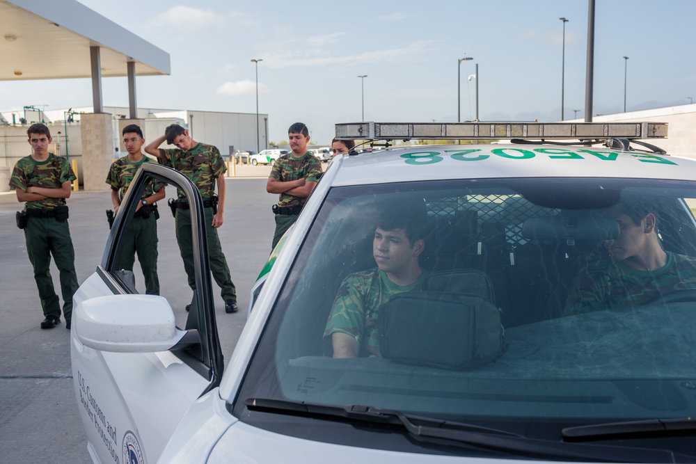 Students from the Border Patrol Explorer Program spend the morning practicing felony (high risk) car stops and searches at at the United States Border Patrol Station in Kingsville Texas Station, 20 July 2017. Kingsville is located in the Rio Grande Valley, and its role is to patrol the largest ranch in Texas. The Explorer program teaches high school students the basics of the Border Patrol. The majority of the students plan to head into the Patrol, law enforcement or militay after graduation.